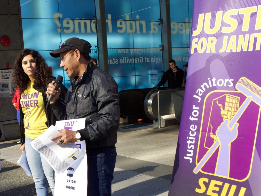 An SEIU member speaks to a crowd