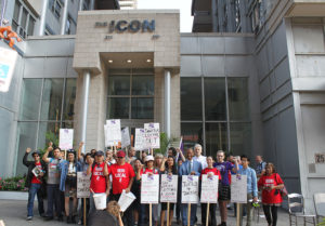 Justice for Janitors members picket outside the Icon building